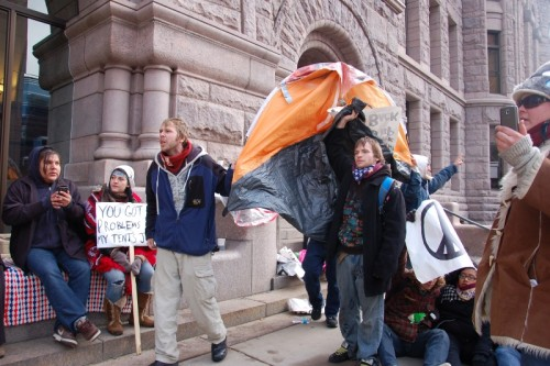 Holding up a tent outside of City Hall