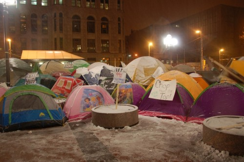 Snow starts to fall on the Plaza, tents protect occupiers from the elements