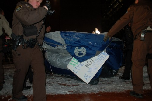 Hennepin County police removing people from tents and confiscating them