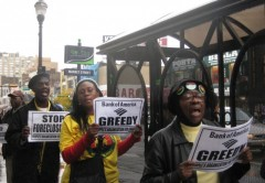 Three picketers protesting Bank of America in Newark