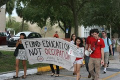 Protesters march to C.W. Bill Young Hall, the ROTC building on USF campus