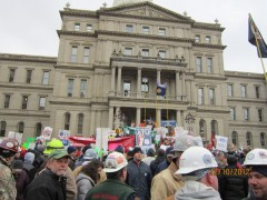 "Workers demonstrate at Michigan Capitol protesting anti-union ""right to work"" la"