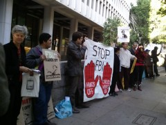 Activists rally outside the courthouse in support of Carlos Montes.