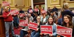 Supporters of Minneapolis Municipal ID at city council meeting.