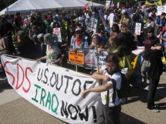 """SDS banner in march says, """"U.S. Out of Iraq Now!"""""""
