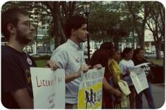 Activists listen to speakers.
