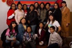 Women join together for a photo celebrating Women's Day in Boyle Heights.