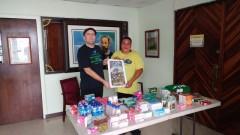 Minnesota union leader  Brad Sigal in San Juan brings money and medicine.