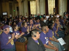 Union janitors, day laborers, and immigrants' rights activists pack the LA City