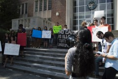Chrisley Carpio of UF SDS addressing students in front of Tigert Hall