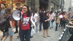 Danica Pagulayan from Anakbayan NY leading protesters in chants