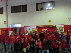 FRSO labor delegation with workers at printing factory.