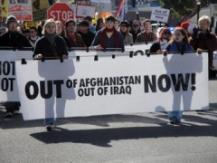 Banner reads U.S. Out of Afghanistan and Iraq Now