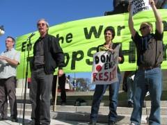 Mick Kelly, standing with three others subpoenaed activists, denounces FBI raids