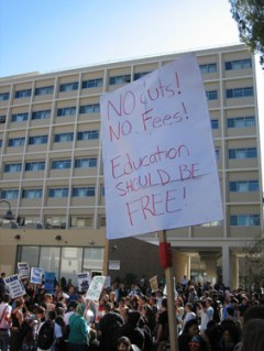 "Sign says ""No Cuts No Fees Education Should be Free"" at UCLA"