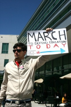Matt Hastings of Tampa Bay SDS holds a sign before the rally.