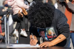 Irma Burns, mother of Jamar Clark, is the first to sign the petition to establis