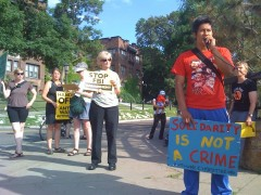 Protestors at bridge in St. Paul in solidarity with Carlos Montes