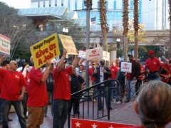 Workers rally at the City Hall steps in Jacksonville, FL