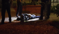 Nearly dead, Alfredo Santibañez on the ground, surrounded by cops.