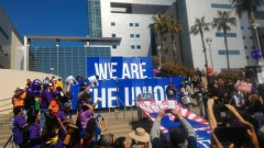 "LA Union members hold signs that read ""We Are the Union."""