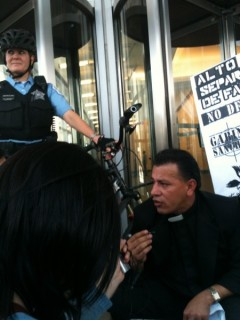 Reverend Landaverde blocks Chicago immigration court entrance.