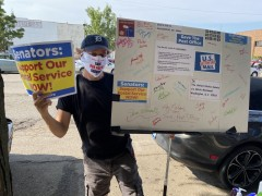 Rural letter carrier Dave Staiger sending giant postcard to U.S. Senator Mitch M