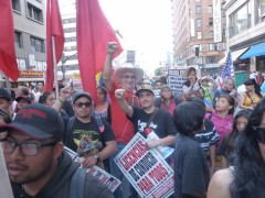 Carlos Montes (center) at LA May Day protest.