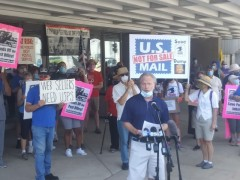 A representative from the APWU in Milwaukee speaks at a rally to defend the post