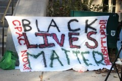 Student activists leave banner at Tulane university's front steps.