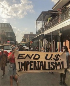 Protesters against U.S. wars  march through the French Quarter.