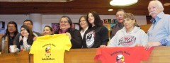 Nina Wilson (center, holding yellow shirt) and several other indigenous rights a
