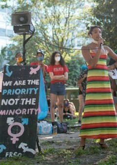 Performance artist Qween Amor speaks at trans rights rally