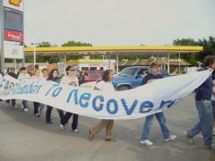Protesters block road to protest factory closure in Moline, IL.
