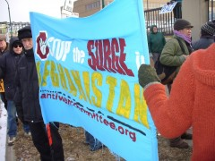 "Anti War Committee banner at December 5 Protest says ""Stop the Surge"""