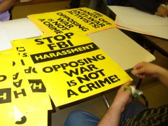 Preparing signs for emergency protest against grand jury witch hunt