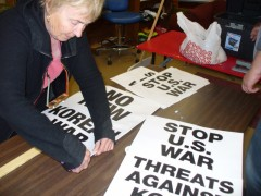 Making signs for April 10 action opposing war with the People's Democratic Repub