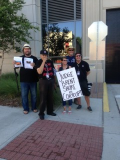 Activists protest to defend their rights at the Duval County Courthouse.
