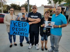 Family of Pedro Echevarria outside hospital. Parents on right.