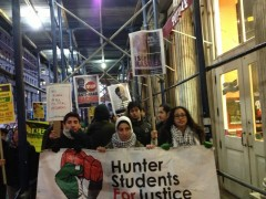 Protestors standing with Rasmea