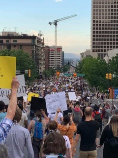 Protestors marching on state street through the center of downtownSalt Lake City