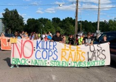 Anti-police crimes protesters line up for march to light rail tracks and MN Stat