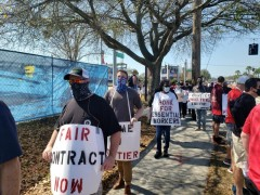 Frontier workers picketing at Super Bowl.