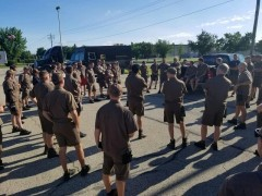 UPS Drivers, of Teamster Local 344, in Oshkosh, WI, hold a parking lot rally
