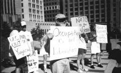 Summer protest with US out of Yugoslavia signs