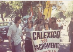 Yvonne on left, holding banner