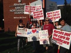 Members of the Minnesota Anti-War Committee picket with striking nurses