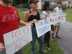 Tampa activists protest at a Tampa area funeral home, Sept. 21, the location of