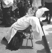 A photo of an effigy of a klansman burning at the rally.