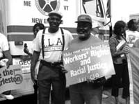 "Sign says ""Workers Rights and Racial Justice"""